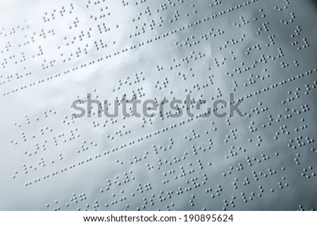 Close up of paper with braille text - stock photo