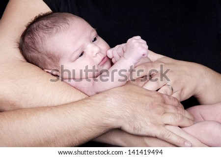 Close Up Of Parents Cuddling Newborn Baby Girl - stock photo
