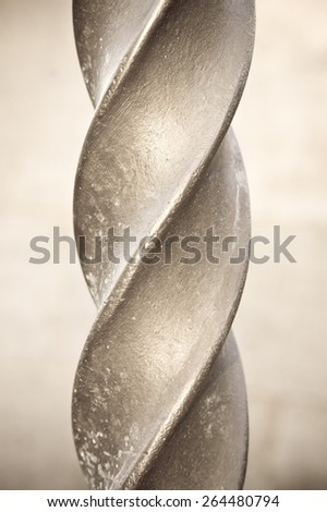 Close up of part of a metal spiral pole in sepia tones - stock photo
