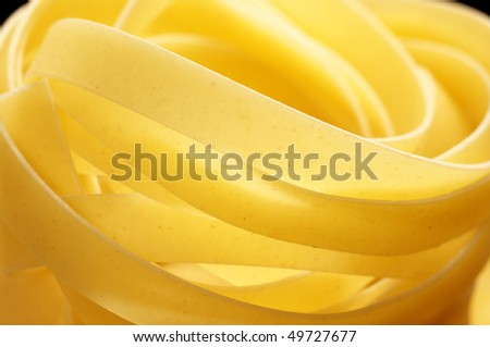 Close-up of pasta (tagliatelle). Selective focus on foreground.