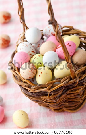 Close-up of pastel colored chocolate Easter egg candy - stock photo