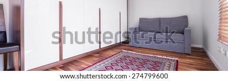 Close-up of pattern carpet in living room - stock photo