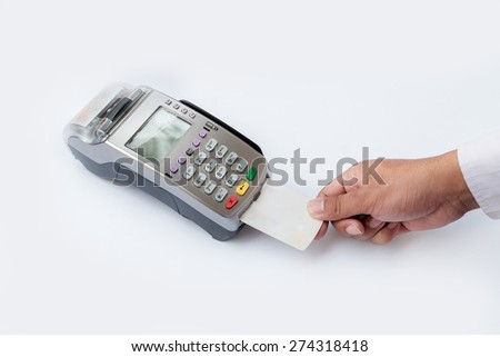 Close-up of payment by credit card on white - stock photo