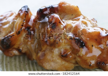 Close-up of peach-grilled chicken on a plate