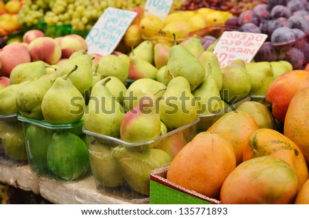 close up of pears and other fruits on market stand in Israel