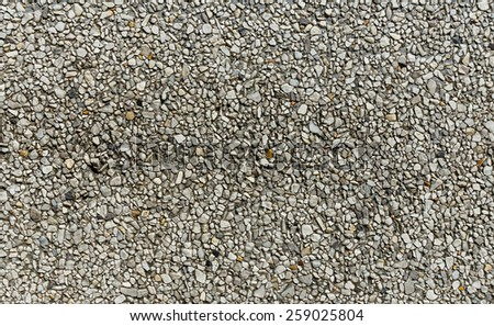 Close up of pebble stones wall texture background - stock photo