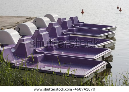 Close-up of pedal boats on the lake