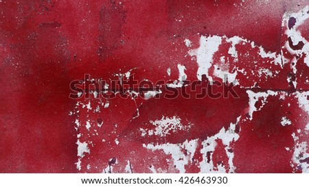 Close up of peeled red paint on grungy  metal surface 16:9