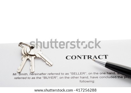 Close-up of pen and keys on contract - stock photo