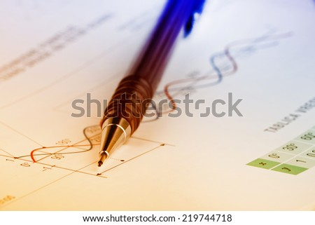 Close up of pen on mathematical background - stock photo