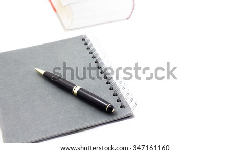 Close-up of pen on notebook business  isolated on the white