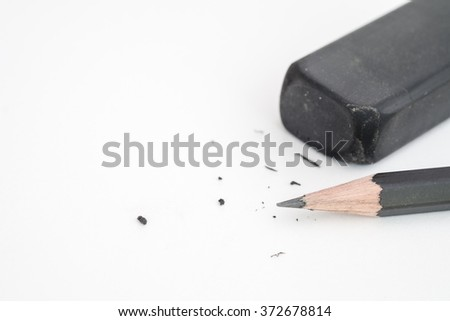 Close up of pencil and eraser on white background - stock photo