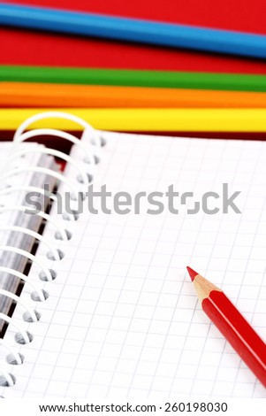 Close-up of pencils and agenda with copy-space. - stock photo