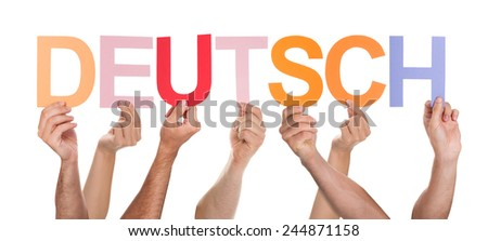 Close-up Of People Hands Holding Colorful Text Deutsch Over White Background - stock photo