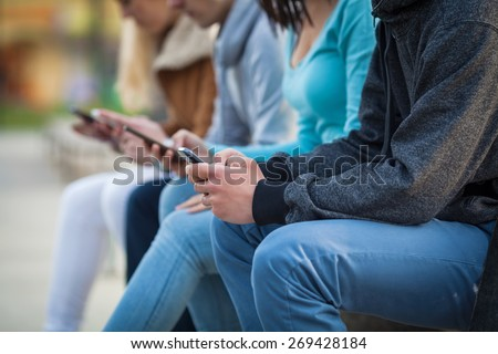 CLose-up of people's hands holding mobile phones