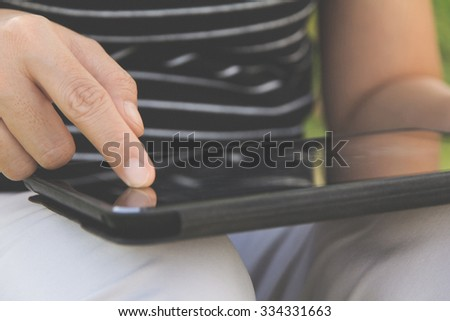close up of people using digital tablet background