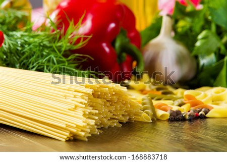 Close up of pepper and other ingredients on kitchen table - stock photo
