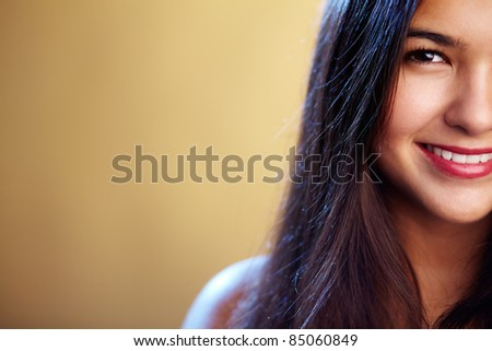 Close-up of perfect woman looking at camera with smile