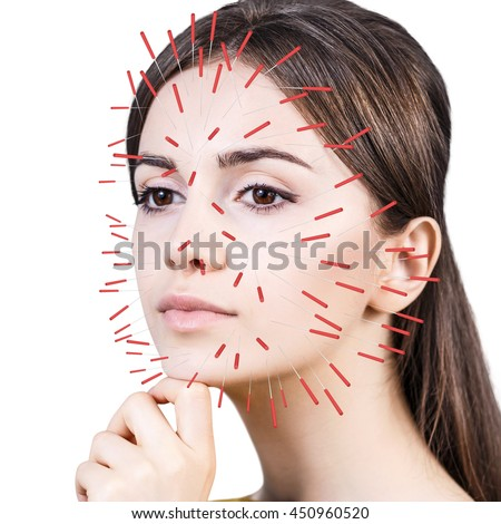 closeup performing acupuncture therapy on face stock photo. Black Bedroom Furniture Sets. Home Design Ideas