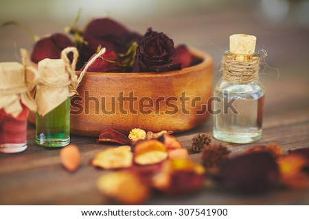 Close-up of perfume product and floral concrete - stock photo