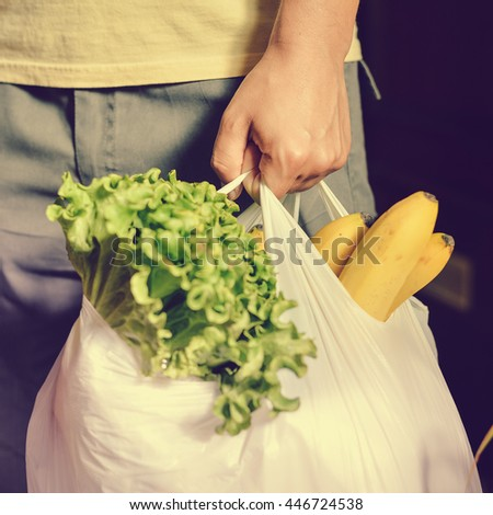 Close up of person hold shopping bag in hand - stock photo