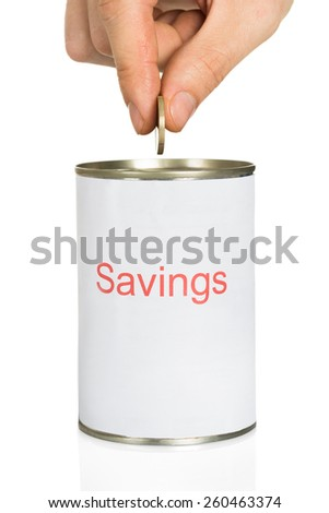 Close-up Of Person Inserting Coin In Can On White Background - stock photo