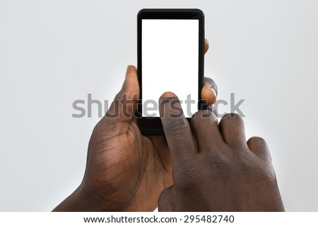 Close-up Of Person's Hand Using Cellphone With Blank Screen - stock photo