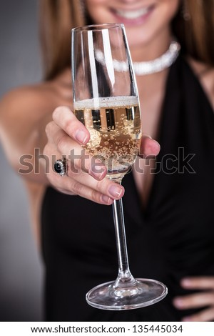 Close-up Of Photo Woman's Hand Offering Champagne - stock photo