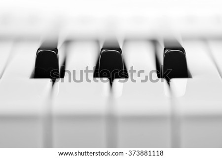 Close-up of piano keyboard. Close frontal view - stock photo