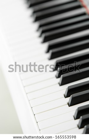 Close up of piano keyboard. Concept of music and art - stock photo