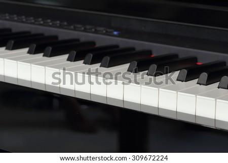 close-up of piano keys of black piano - stock photo