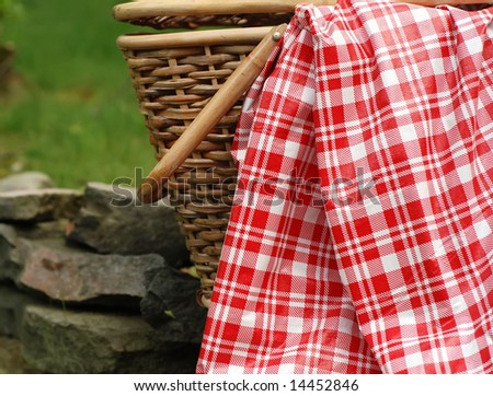 close-up of picnic basket and checked tablecloth - stock photo