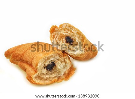 close up of pieces of croissants arranged on white background