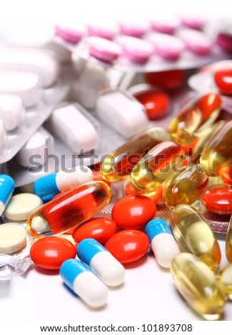 Close up of pills over white background