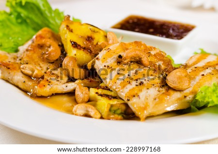 Close Up of Pineapple Cashew Chicken Dish with Dipping Sauce