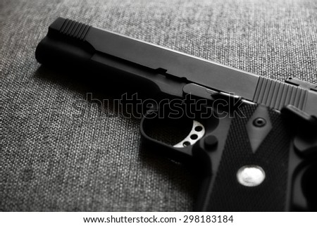 Close up of pistol. 11 mm or 0.45. Black and White. Shallow depth of field. - stock photo