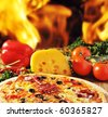 Close up of  pizza with tomatoes, cheese, black olives and  peppers. - stock photo