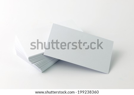 Close up of plain business cards on white background - stock photo