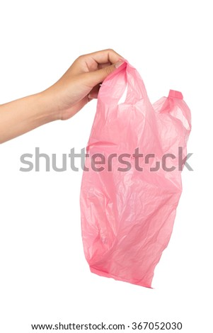 Close up of plastic bag holding by hand isolated on white background - stock photo