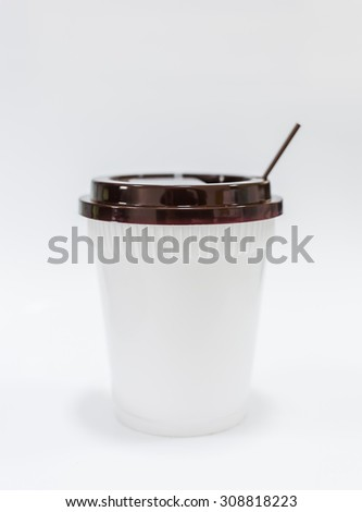 Close up of plastic coffee cup on white background.