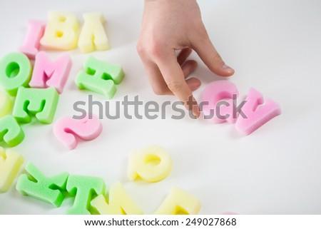 Close-up of plastic colorful initials of curriculum vitae - stock photo