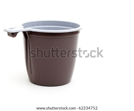 close up of plastic cup of coffee on white background