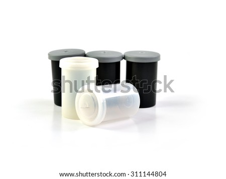 Close up of plastic film roll case isolated on white background, selective focus. - stock photo
