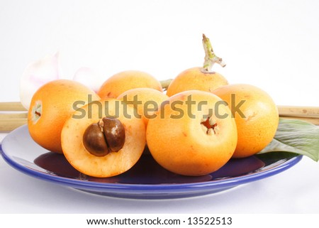 Close up of plate with Chinese loquats - stock photo
