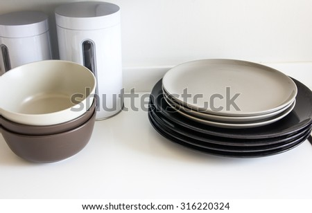 close up of plates stacking on the table