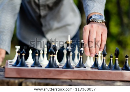 Close-up of player's hand executing his winning move