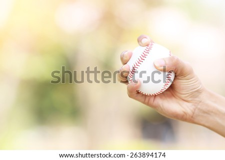 Close-up of player's hand holding baseball - stock photo