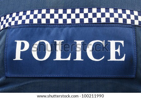 Close-up of police logo on policeman uniform. - stock photo