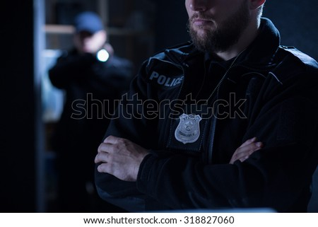 Close-up of police officers on the intervention - stock photo