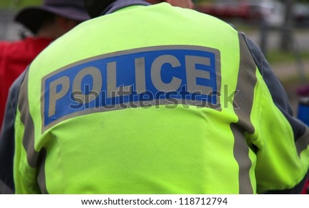 Close up of policeman's back - stock photo